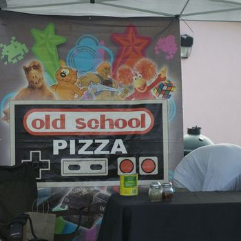 Old School Pizza sets up their booth