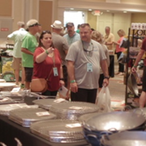 Attendees shopping at the indoor vendor area